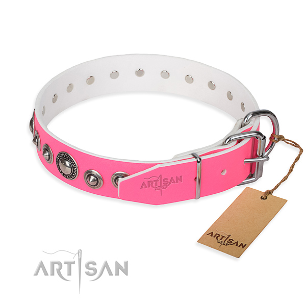 Genuine leather dog collar made of gentle to touch material with reliable studs